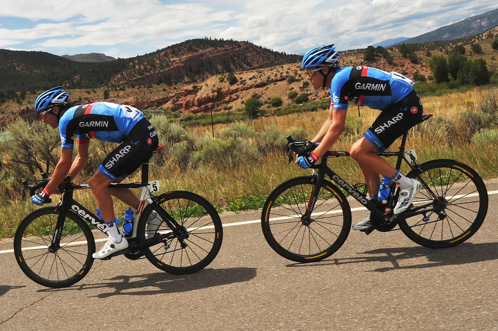 . David Millar (#5) and Rohan Dennis (#4) of team Garmin-Sharp go downhill after the 2nd King of Mountain hill during the 103.7-mile fourth stage from Steamboat Springs to Beaver Creek, Colorado. August 22, 2013. (Photo by Hyoung Chang/The Denver Post)