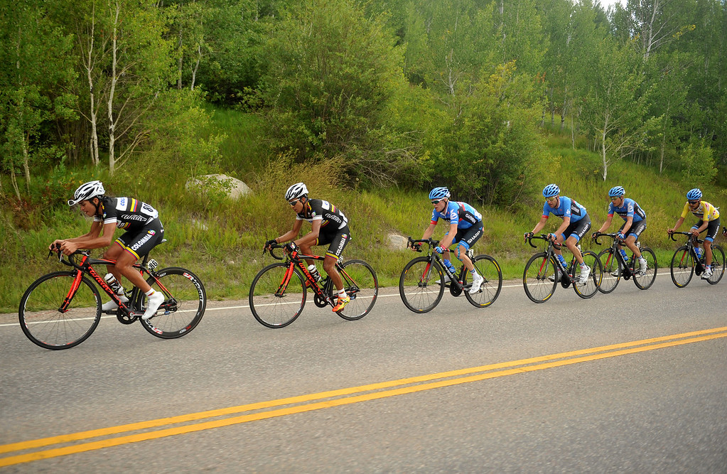 . Fabio Duarte of Team Columbia (86) and a group of cyclists go downhill after Bachelor Gulch during the 103.7-mile fourth stage of 2013 USA Pro Challenge race from Steamboat Springs to Beaver Creek, Colorado, August 22, 2013. (Photo by Hyoung Chang/The Denver Post)