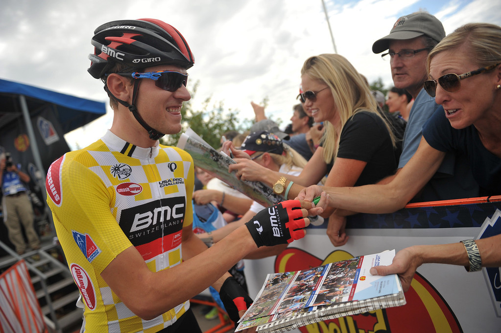 . Race leader Tejay Van Garderen of BMC Racing Team signs autographs for the fans by the start line of the 115.2 mile 6th stage from Loveland to Fort Collins, Colorado. August 24, 2013. (Photo by Hyoung Chang/The Denver Post)