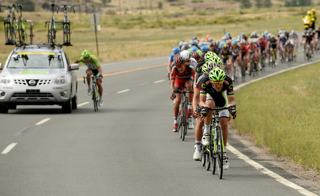 . Peter Sagan of Cannondale Pro Cycling Team, left, and the peloton are chasing the leaders by Horsetooth Reservoir during the 115.2 mile 6th stage of 2013 USA Pro Challenge race from Loveland to Fort Collins, Colorado. August 24, 2013. (Photo by Hyoung Chang/The Denver Post)