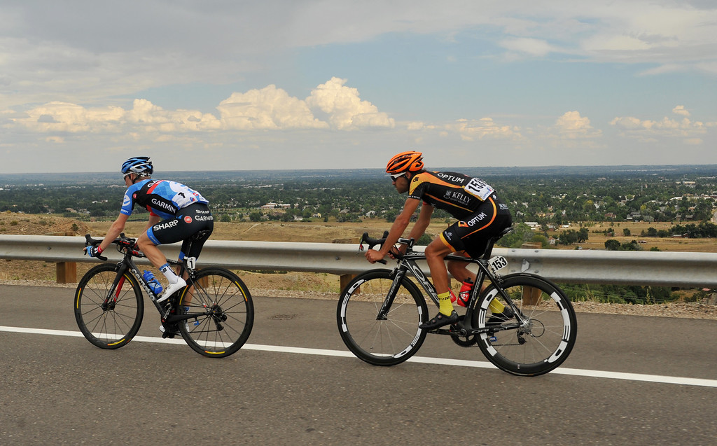 . Christian Vandevelde of Team Garmin-Sharp, left, and Jesse Anthony of Optum p/b Kelly Benefit Strategies are about 10 miles away from the finish line during during the 115.2 mile 6th stage from Loveland to Fort Collins, Colorado. August 24, 2013. (Photo by Hyoung Chang/The Denver Post)