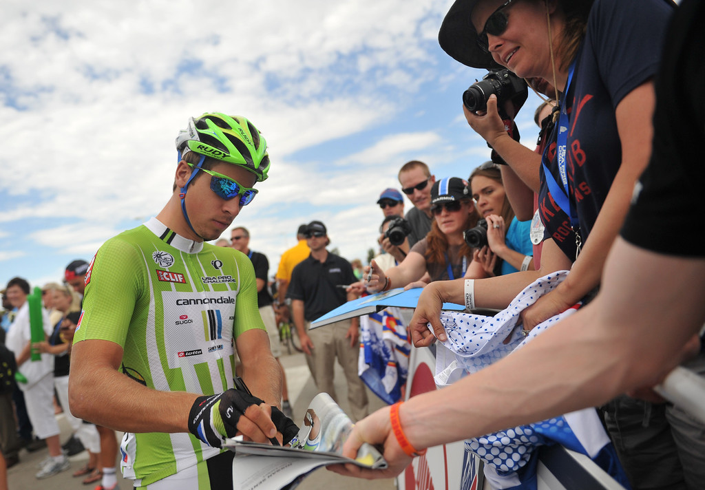 . Peter Sagan of Cannondale Pro Cycling Team signs autographs for the fans by the start line of the 115.2 mile 6th stage from Loveland to Fort Collins, Colorado. August 24, 2013. (Photo by Hyoung Chang/The Denver Post)