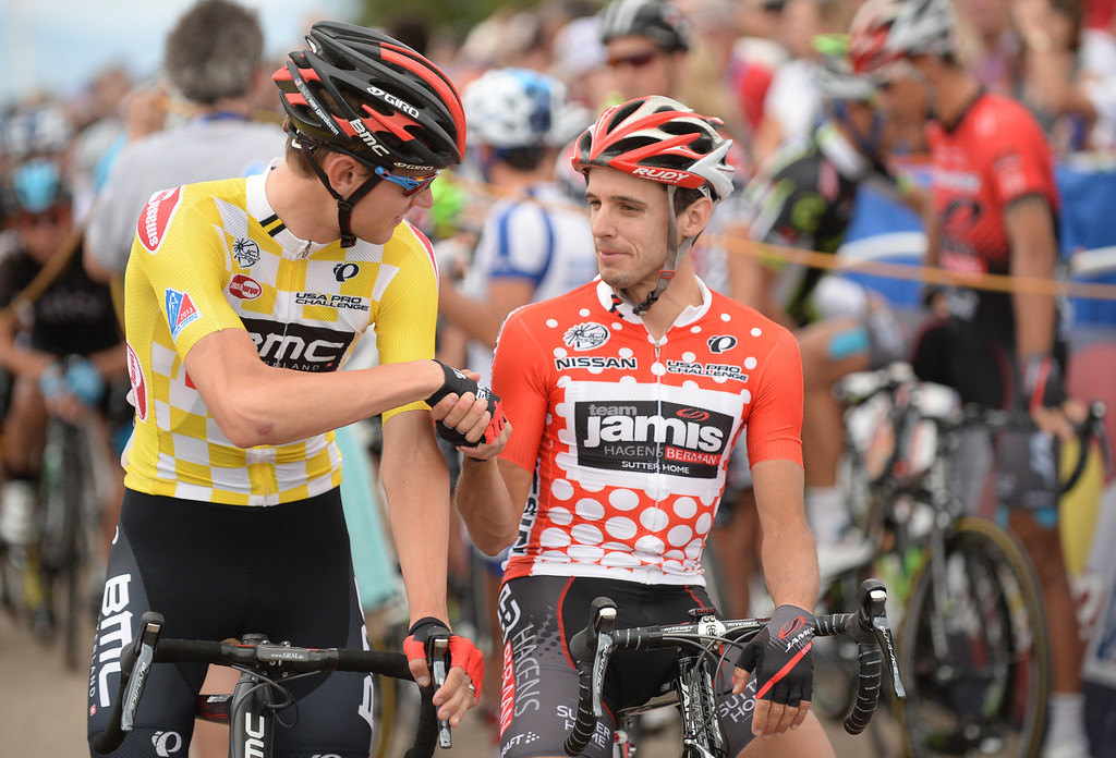 . Race leader Tejay Van Garderen of BMC Racing Team, left, shakes hands with King of the Mountains Matt Cook of Jamis-Hagens Berman at the start line of the115.2 mile 6th stage of 2013 USA Pro Challenge race from Loveland to Fort Collins, Colorado. August 24, 2013. (Photo by Hyoung Chang/The Denver Post)