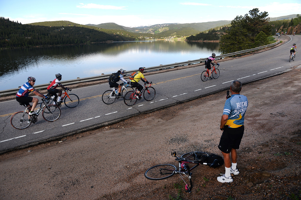 . Cyclist Paul Gregg, of Salida, Colorado, takes a picture of Barker Reservoir in Nederland, CO, after making the 18-mile ascent up Boulder Canyon (Photo By Helen H. Richardson/ The Denver Post)