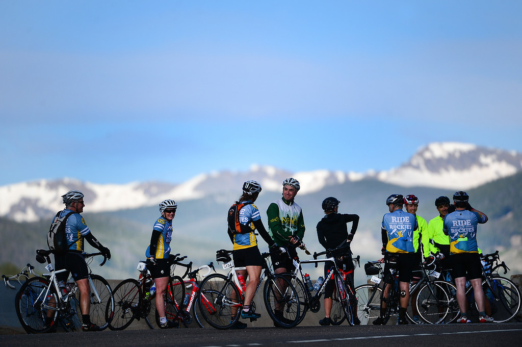 . Cyclists enjoy the view of Eldora ski area and the high peaks outside of Nederland, Colorado, after finishing the 18 miles up Boulder Canyon on June 8, 2014 during the first day of the annual Ride the Rockies tour.  More than 2,000 cyclists are taking part in the annual ride. The first stage started at Fairview High School in Boulder headed up Boulder Canyon through the town of Nederland, continued along the Peak-to-Peak Highway through Black Hawk and Central City down to Highway I-70.  From there cyclists took the frontage road to Hwy 40 to go up and over Berthoud Pass and end the day in Winter Park. (Photo By Helen H. Richardson/ The Denver Post)