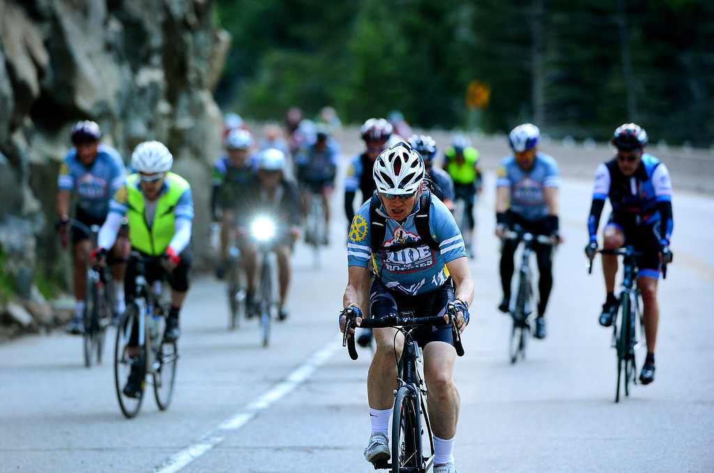 . Cyclists make their way through the Narrows, the steepest climb up Boulder Canyon, in Boulder, CO on June 8, 2014.   (Photo By Helen H. Richardson/ The Denver Post)