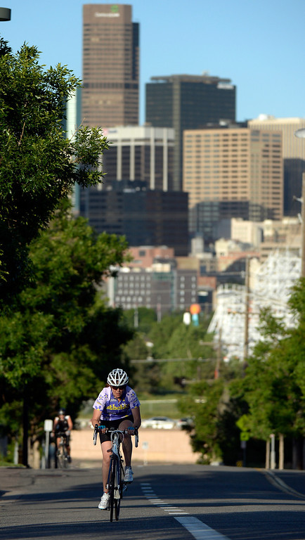 """. DENVER, CO - JUNE 9:  Tanya Berlin rides up the hill on  W. 20th Ave. next to Sports Authority Field as she participates in the \""""Bicycle Bootcamp\""""  on Monday, June 9, 2014. The  bootcamp readies riders for climbing mountain passes this summer.  (Denver Post Photo by Cyrus McCrimmon)"""
