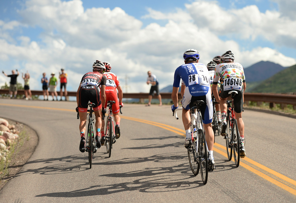 . Danny Summerhill of UnitedHealthecare Pro Cycling (78) and Cyclists are climbing in the 1st Stage of 2014 USA Pro Challenge. Aspen, Colorado. August 18. 2014. The Aspen/Snowmass Circuit is 65 miles (3 laps of nearly 22 miles each), and 2,300 ft. of climbing per lap. (Photo by Hyoung Chang/The Denver Post)