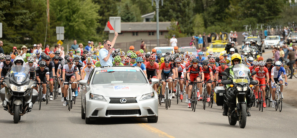 . Cyclists are leaving downtown Aspen for the 1st Stage of 2014 USA Pro Challenge. Aspen, Colorado. August 18. 2014. The Aspen/Snowmass Circuit is 65 miles (3 laps of nearly 22 miles each), and 2,300 ft. of climbing per lap. (Photo by Hyoung Chang/The Denver Post)