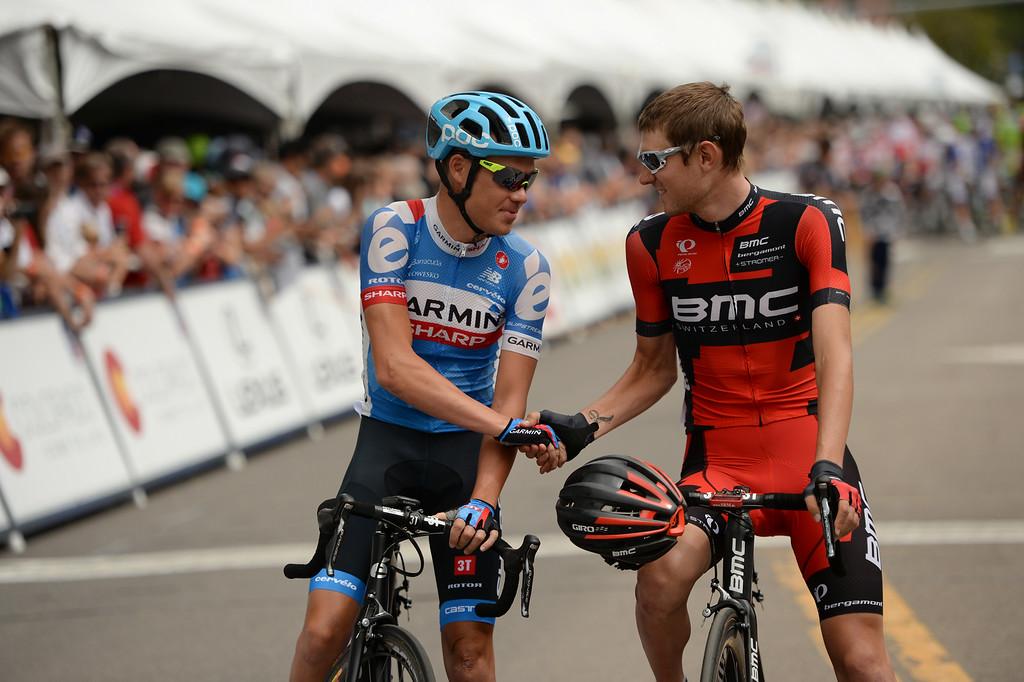 . Thomas Danielson of Team Garmin-Sharp, left, shakes hands with Tejay Van Garderen of BMC Racing Team at the start line of  1st Stage of 2014 USA Pro Challenge. Aspen, Colorado. August 18. 2014. The Aspen/Snowmass Circuit is 65 miles (3 laps of nearly 22 miles each), and 2,300 ft. of climbing per lap. (Photo by Hyoung Chang/The Denver Post)