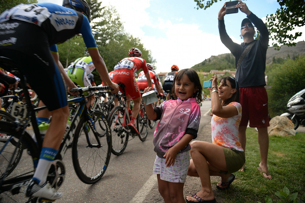 . A young fan cheers for cyclists during the 1st Stage of the 2014 USA Pro Challenge. Aspen, Colorado. August 18. 2014. The Aspen/Snowmass Circuit is 65 miles (3 laps of nearly 22 miles each), and 2,300 ft. of climbing per lap. (Photo by Hyoung Chang/The Denver Post)