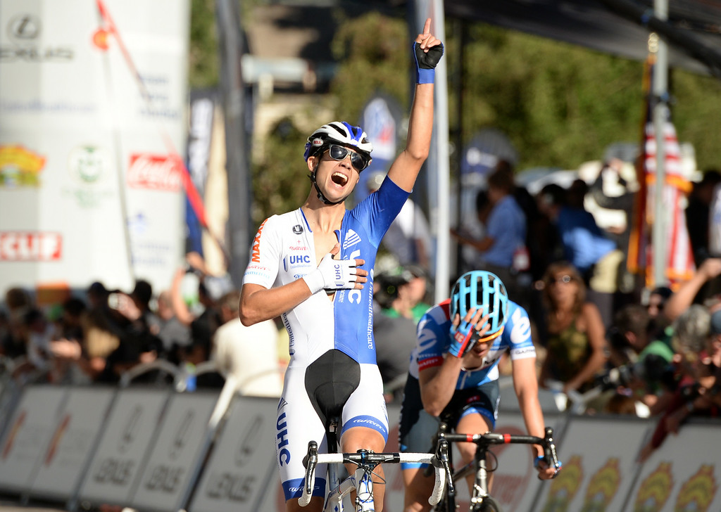 . Kiel Reijnen of UnitedHealthcare Pro Cycling, left, celebrates winning of  the 1st Stage of 2014 USA Pro Challenge by Alex Howes of Team Garmin - Sharp. Aspen, Colorado. August 18. 2014. The Aspen/Snowmass Circuit is 65 miles (3 laps of nearly 22 miles each), and 2,300 ft. of climbing per lap. (Photo by Hyoung Chang/The Denver Post)