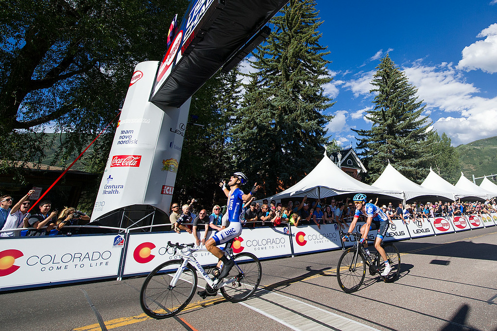 . Kiel Reijnen of the UnitedHealthcare Pro Cycling Team, left, reacts after crossing the line to win the 60.6-mile Stage 1 of the USA Pro Challenge on August 18, 2014, in Aspen, Colorado. Alex Howes of Team Garmin-Sharp, right, finished second. (Photo by Daniel Petty/The Denver Post)