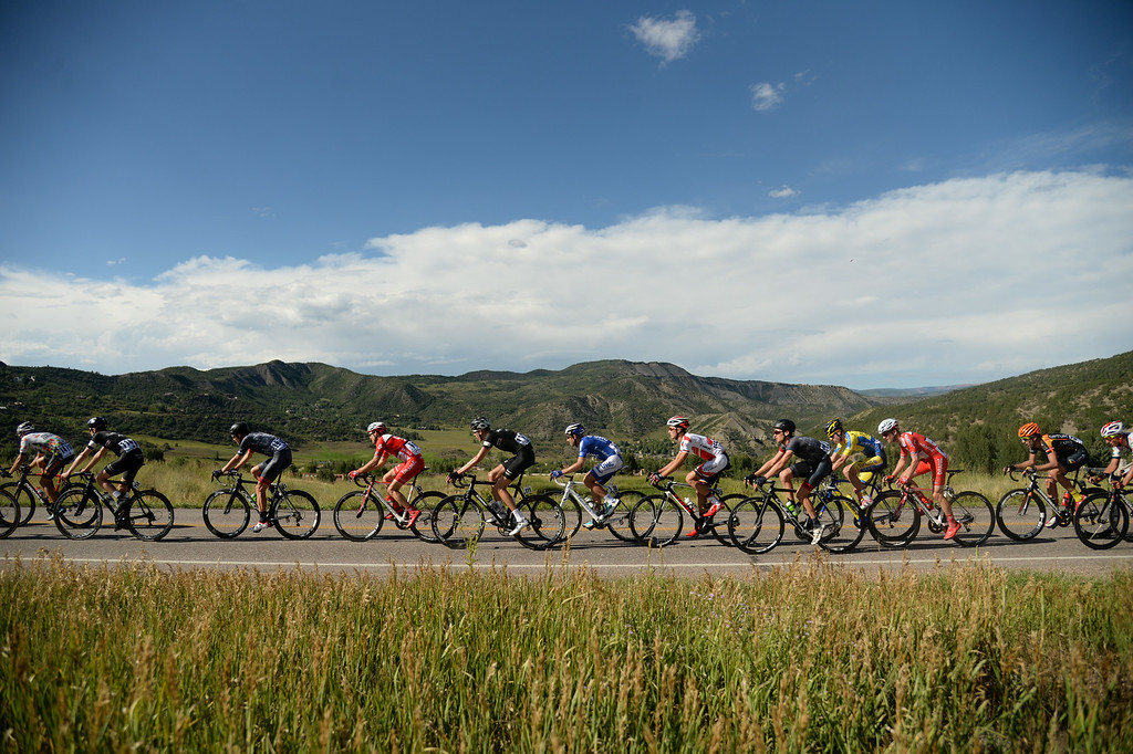 . Cyclists race in the 1st Stage of 2014 USA Pro Challenge. Aspen, Colorado. August 18. 2014. The Aspen/Snowmass Circuit is 65 miles (3 laps of nearly 22 miles each), and 2,300 ft. of climbing per lap. (Photo by Hyoung Chang/The Denver Post)