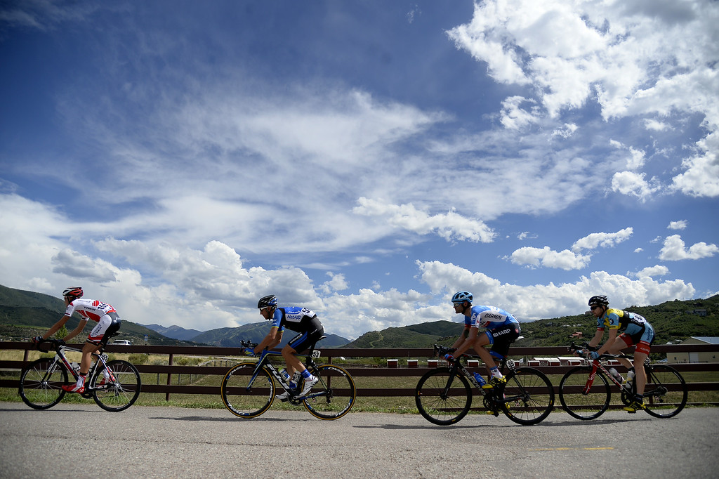 . Riders cross CO-82 during the USA Pro Challenge on Monday, August, 18, 2014. (AAron Ontiveroz, The Denver Post)