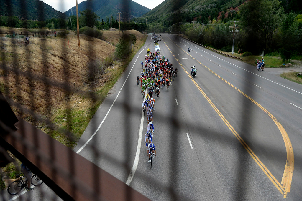 . The pack crosses beneath Wingo Junction Bridge on CO-82 during stage 2. The USA Pro Challenge stage 2 on Tuesday, August 19, 2014. (Photo by AAron Ontiveroz/The Denver Post)