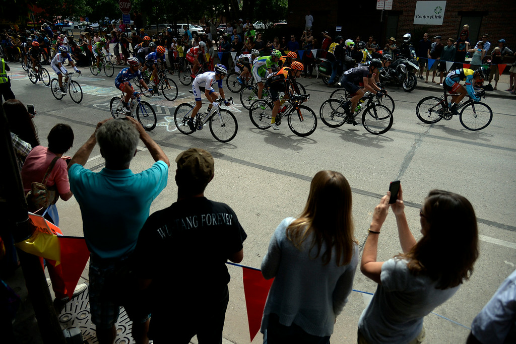 . Riders cruise down Main Street during stage 2. The USA Pro Challenge stage 2 on Tuesday, August 19, 2014. (Photo by AAron Ontiveroz/The Denver Post)