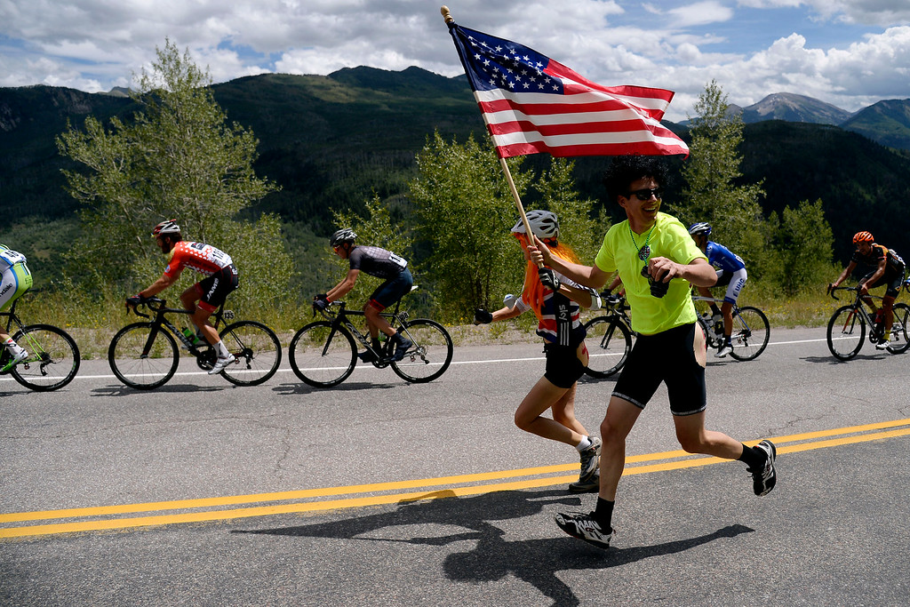 . Supporters run alongside riders during stage 2. The USA Pro Challenge stage 2 on Tuesday, August 19, 2014. (Photo by AAron Ontiveroz/The Denver Post)