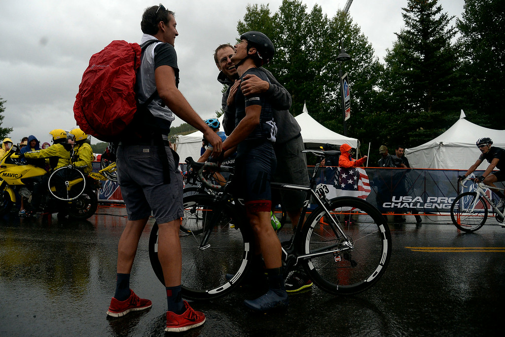 . Robin Carpenter of Hincape Sportsear Development Team is congratulated after winning stage 2. The USA Pro Challenge stage 2 on Tuesday, August 19, 2014. (Photo by AAron Ontiveroz/The Denver Post)