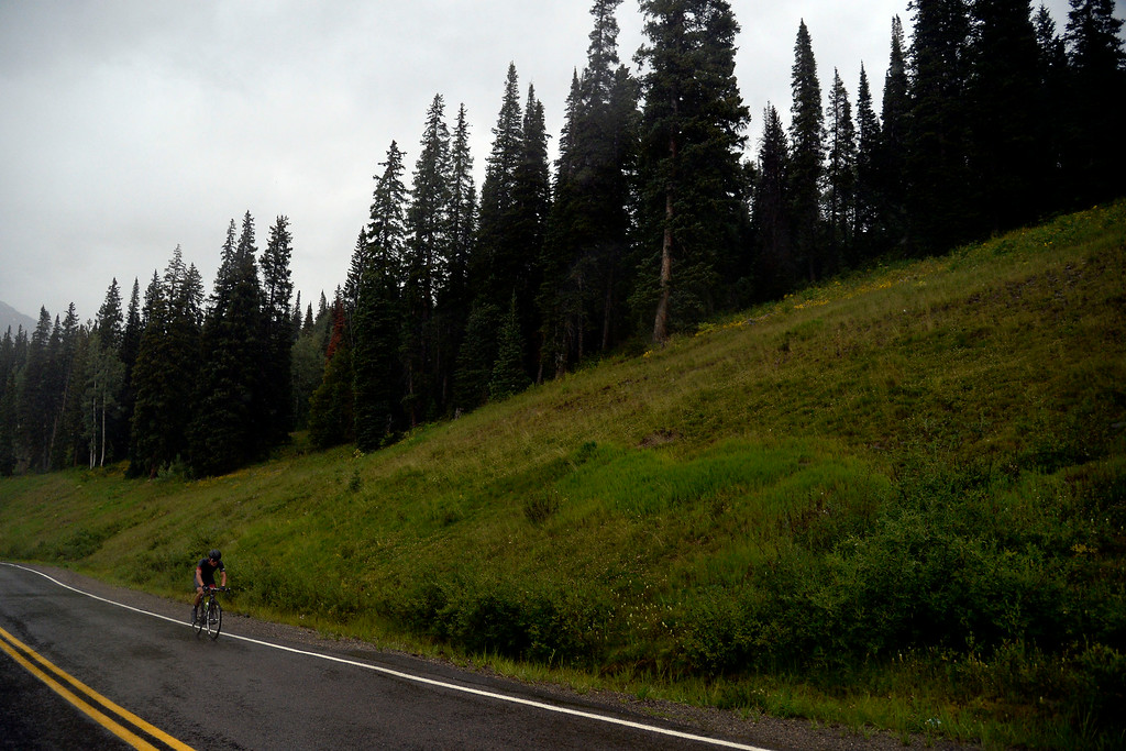 . Robin Carpenter leads the field as he climbs a hill alone en route to a stage 2 win. The USA Pro Challenge stage 2 on Tuesday, August 19, 2014. (Photo by AAron Ontiveroz/The Denver Post)
