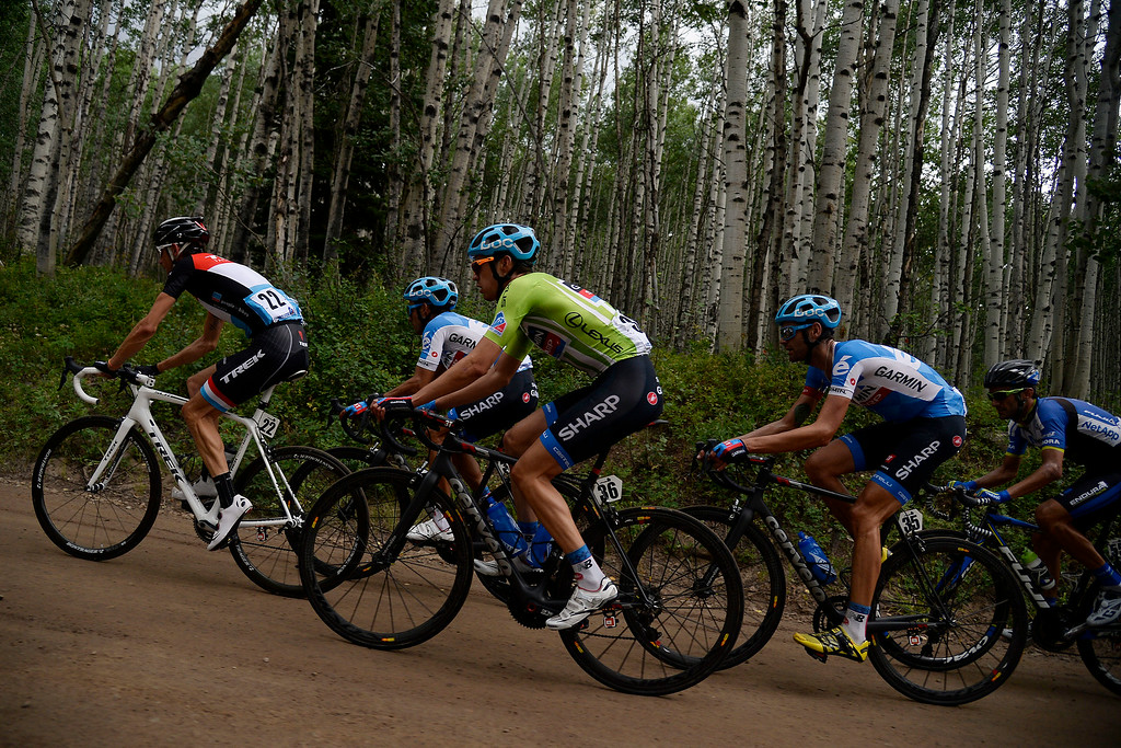 . Garmin-Sharp team member Alex Howes (36) rides amidst the pack shortly before a brief race delay in the aspen trees outside of Crested Butte. The USA Pro Challenge stage 2 on Tuesday, August 19, 2014. (Photo by AAron Ontiveroz/The Denver Post)