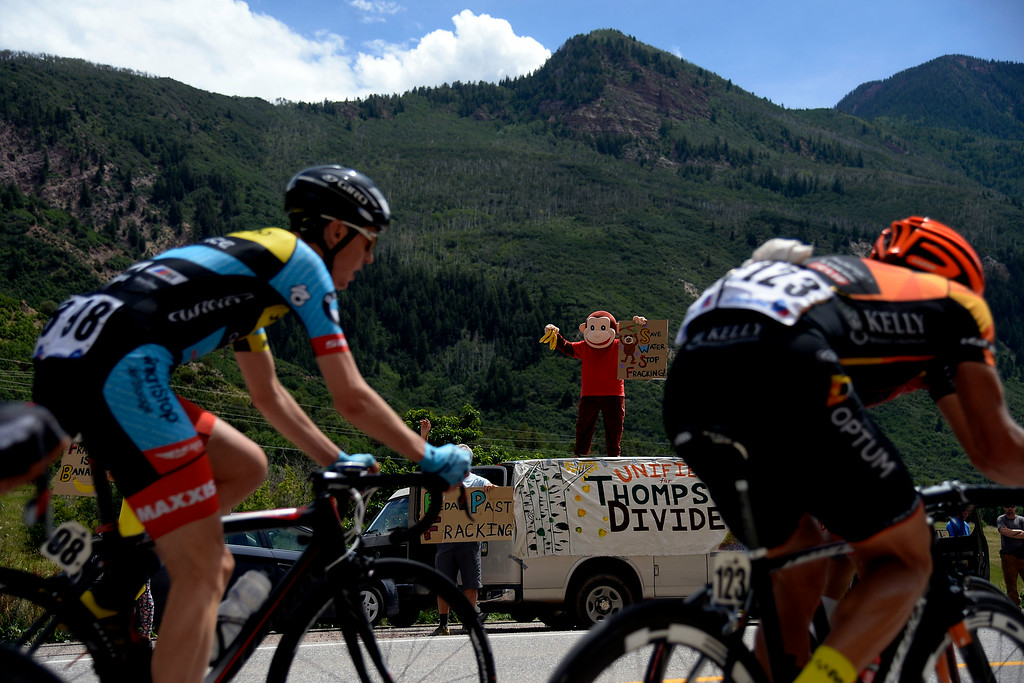 . A man in a monkey costume supports riders as they ride the early miles of stage 2. The USA Pro Challenge stage 2 on Tuesday, August 19, 2014. (Photo by AAron Ontiveroz/The Denver Post)