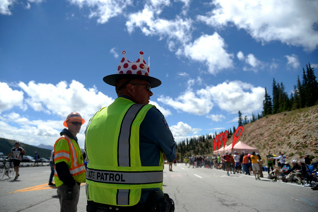 . Trooper Joe Chinn wears a festive crown over his state-issued hat during stage 3. The USA Pro Challenge stage 3 on Wednesday, August 20, 2014. (Photo by AAron Ontiveroz/The Denver Post)