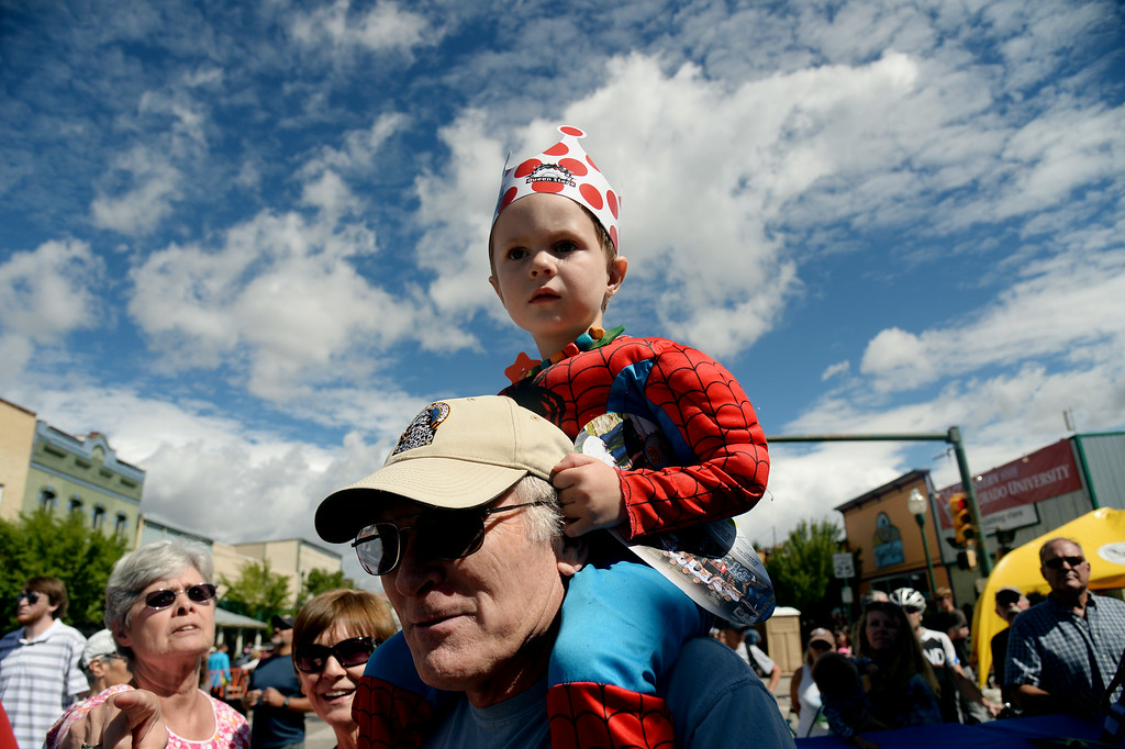 . Caleb White, 3, of Crested Butte, top, welcomes cyclists with his grandfather Jim at Downtown Gunnison. August 20, 2014. Stage 3 started in Gunnison and headed east for 35 miles before tackling the 11,300 ft. Monarch Pass. The riders descend the eastern slope of the pass and did two 9-mile loops through Salida and the surrounding countryside. (Photo by Hyoung Chang/The Denver Post)