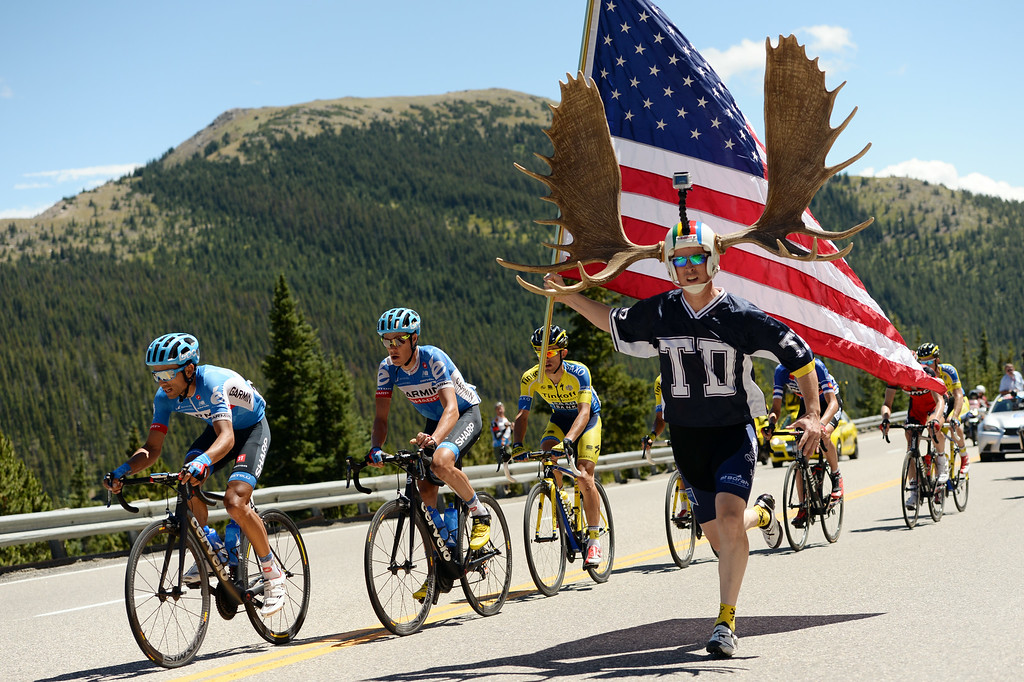 . Dore Holte cheer cyclists of USA Pro Challenge at the summit of Monarch Pass. August 20, 2014. Stage 3 started in Gunnison and headed east for 35 miles before tackling the 11,300 ft. Monarch Pass. The riders descend the eastern slope of the pass and did two 9-mile loops through Salida and the surrounding countryside. (Photo by Hyoung Chang/The Denver Post)
