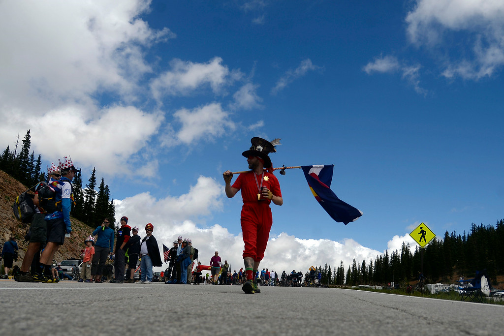 . Mike Craghead carries a Colorado State flag in support of cyclists riding in stage 3. The USA Pro Challenge stage 3 on Wednesday, August 20, 2014. (Photo by AAron Ontiveroz/The Denver Post)