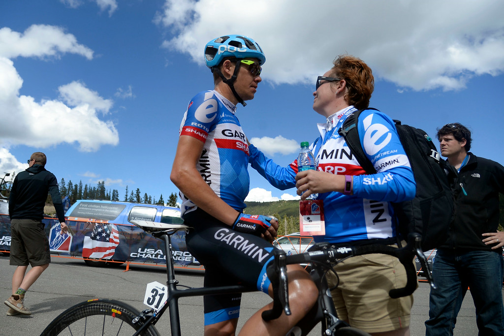 . Tom Danielson of Garmin-Sharp, who finished the stage in fourth, speaks with Alyssa Morahan, shortly after crossing the line during stage 3. The USA Pro Challenge stage 3 on Wednesday, August 20, 2014. (Photo by AAron Ontiveroz/The Denver Post)