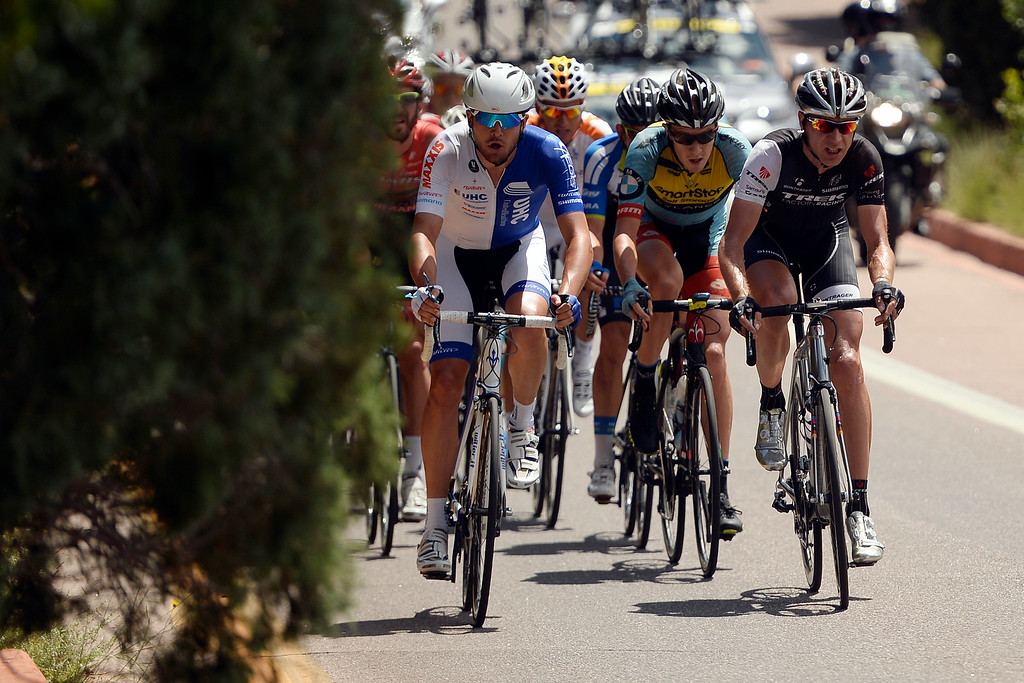 . COLORADO SPRINGS, CO - AUGUST 21: Danny Summerhill (left) and Jens Voigt (right) battle to take an early lead in the Garden of the Gods during stage 4. The USA Pro Challenge stage 4 on Thursday, August 21, 2014. (Photo by AAron Ontiveroz/The Denver Post)