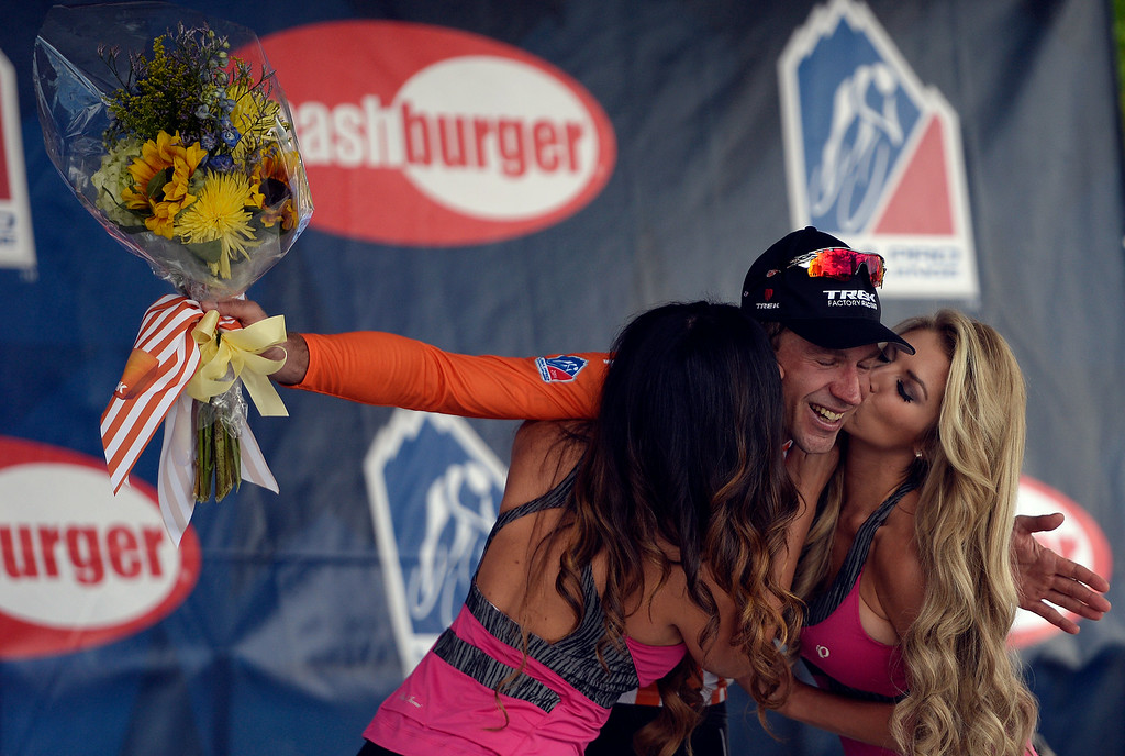 . COLORADO SPRINGS, CO - AUGUST 21: Jens Voigt is kissed by models after earning the orange jersey for most courageous rider at the close of stage 4. The USA Pro Challenge stage 4 on Thursday, August 21, 2014. (Photo by AAron Ontiveroz/The Denver Post)