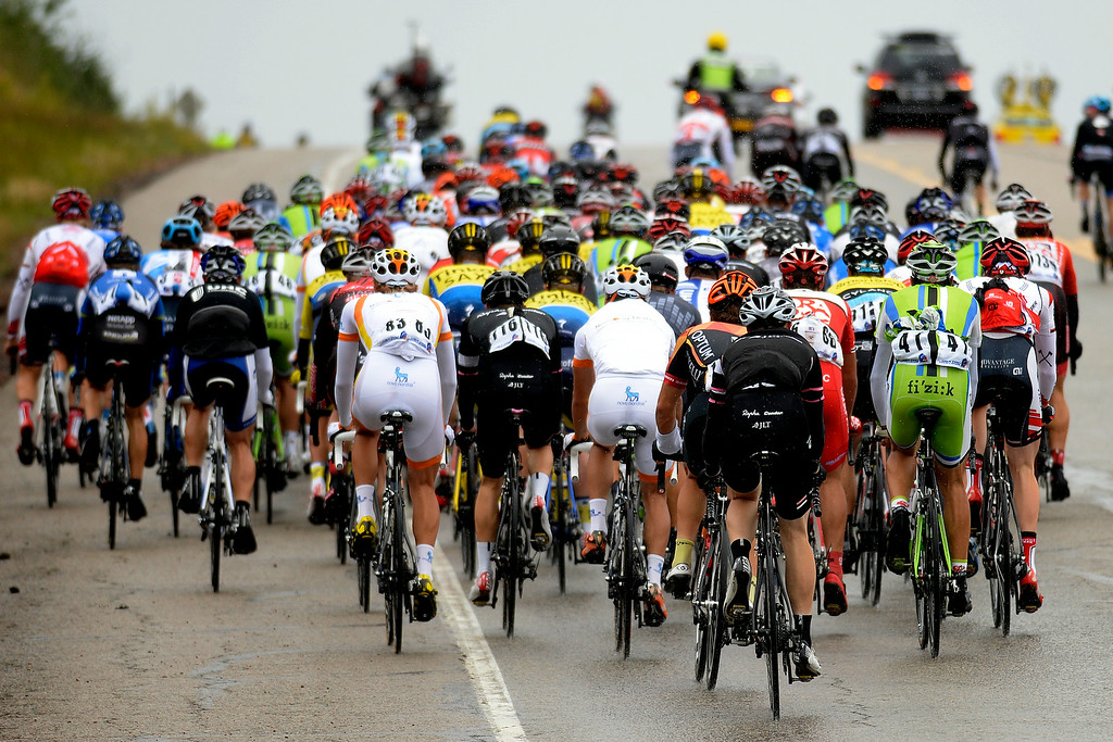 . BRECKENRIDGE, CO - AUGUST 22: The pack climbs one of many small hills during stage 5. The USA Pro Challenge stage 5 on Friday, August 22, 2014. (Photo by AAron Ontiveroz/The Denver Post)