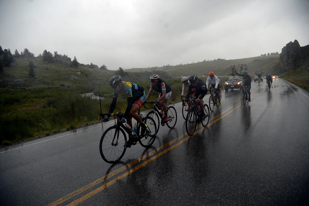 . BRECKENRIDGE, CO - AUGUST 22: Rob Britton leads a pack down a hill in the rain during stage 5. The USA Pro Challenge stage 5 on Friday, August 22, 2014. (Photo by AAron Ontiveroz/The Denver Post)