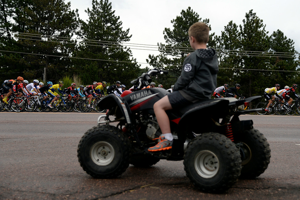 . BRECKENRIDGE, CO - AUGUST 22: Chance Baird, 6, watches as the riders make their way past him and his family. The USA Pro Challenge stage 5 on Friday, August 22, 2014. (Photo by AAron Ontiveroz/The Denver Post)
