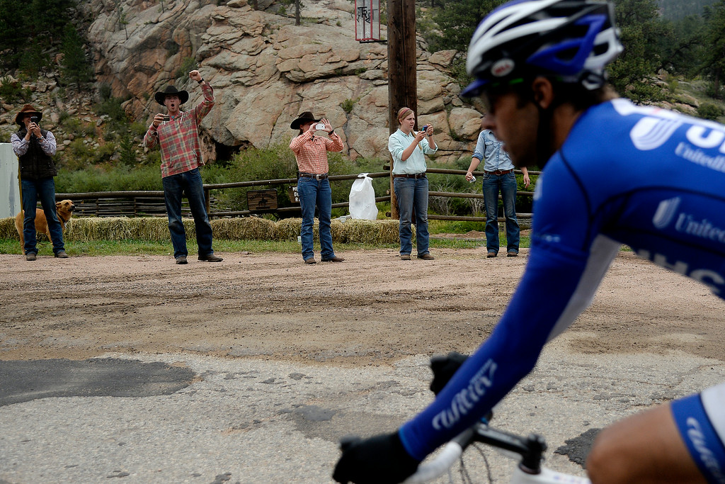 . BRECKENRIDGE, CO - AUGUST 22: Cowboys cheer for the riders during stage 5. The USA Pro Challenge stage 5 on Friday, August 22, 2014. (Photo by AAron Ontiveroz/The Denver Post)