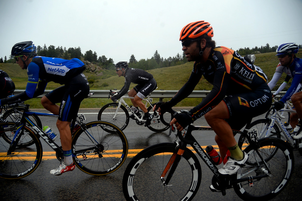 . BRECKENRIDGE, CO - AUGUST 22: From left: Gregor Muhlberger (57), Markel Irizar Aranburu (24) and Mike Friedman pedal through the rain during stage 5. The USA Pro Challenge stage 5 on Friday, August 22, 2014. (Photo by AAron Ontiveroz/The Denver Post)