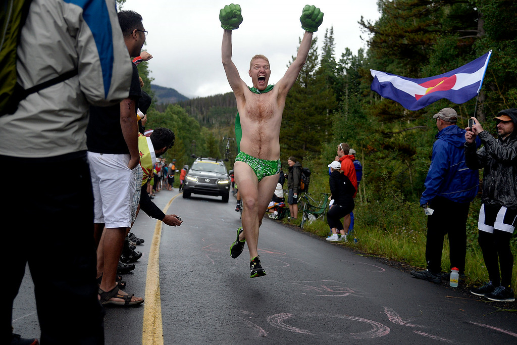 . VAIL, CO - AUGUST 23: Ivan Basso races behind fan Dave Severenuk during stage 6. The USA Pro Challenge stage 6 time trial on Saturday, August 23, 2014. (Photo by AAron Ontiveroz/The Denver Post)