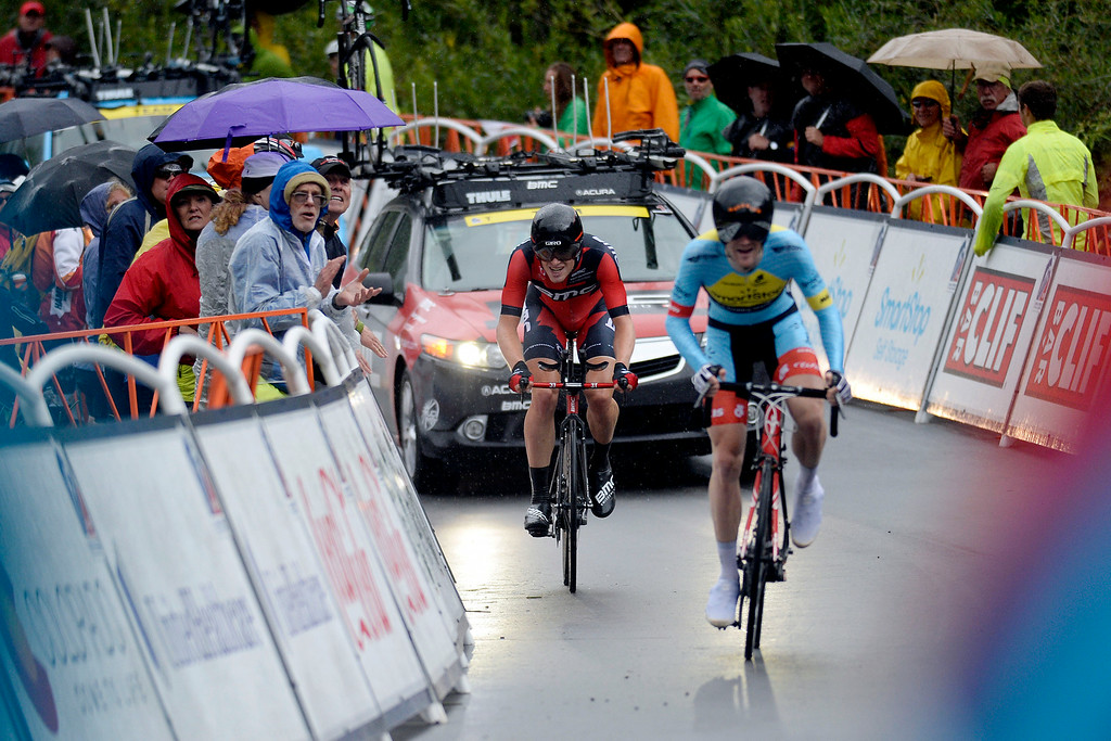 . VAIL, CO - AUGUST 23: Ben Hermans trails Julian Kyer during the stage 6 finish. The USA Pro Challenge stage 6 time trial on Saturday, August 23, 2014. (Photo by AAron Ontiveroz/The Denver Post)