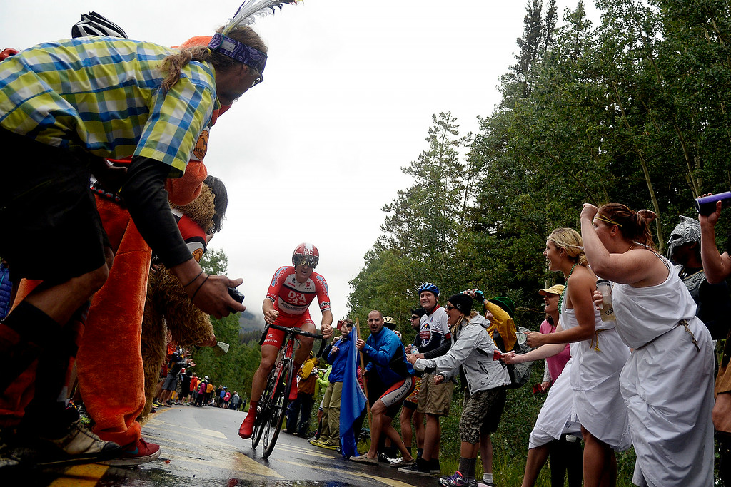 . VAIL, CO - AUGUST 23: Fans cheer on Bernard Sulzberger during stage 6. The USA Pro Challenge stage 6 time trial on Saturday, August 23, 2014. (Photo by AAron Ontiveroz/The Denver Post)