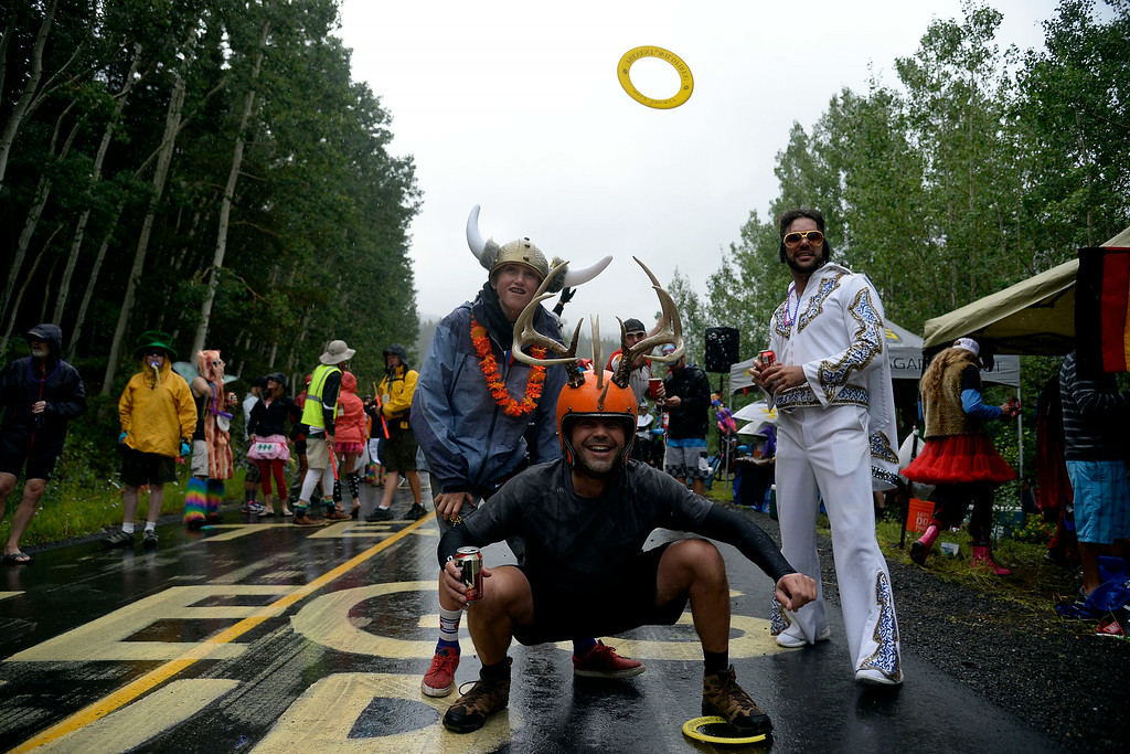 . VAIL, CO - AUGUST 23: David Hieb (squatting), Liam Hanagan (back left) and Ryan Flores (Elvis) play ring toss during a party at stage 6. The USA Pro Challenge stage 6 time trial on Saturday, August 23, 2014. (Photo by AAron Ontiveroz/The Denver Post)