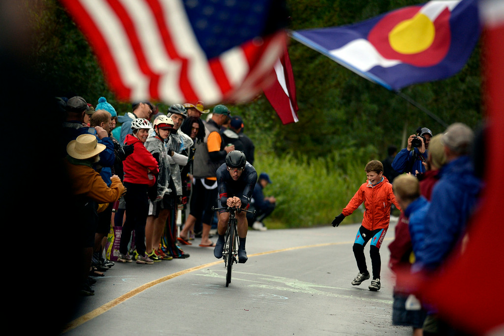 . VAIL, CO - AUGUST 23: Fans cheer on Tyler Magner during stage 6. The USA Pro Challenge stage 6 time trial on Saturday, August 23, 2014. (Photo by AAron Ontiveroz/The Denver Post)