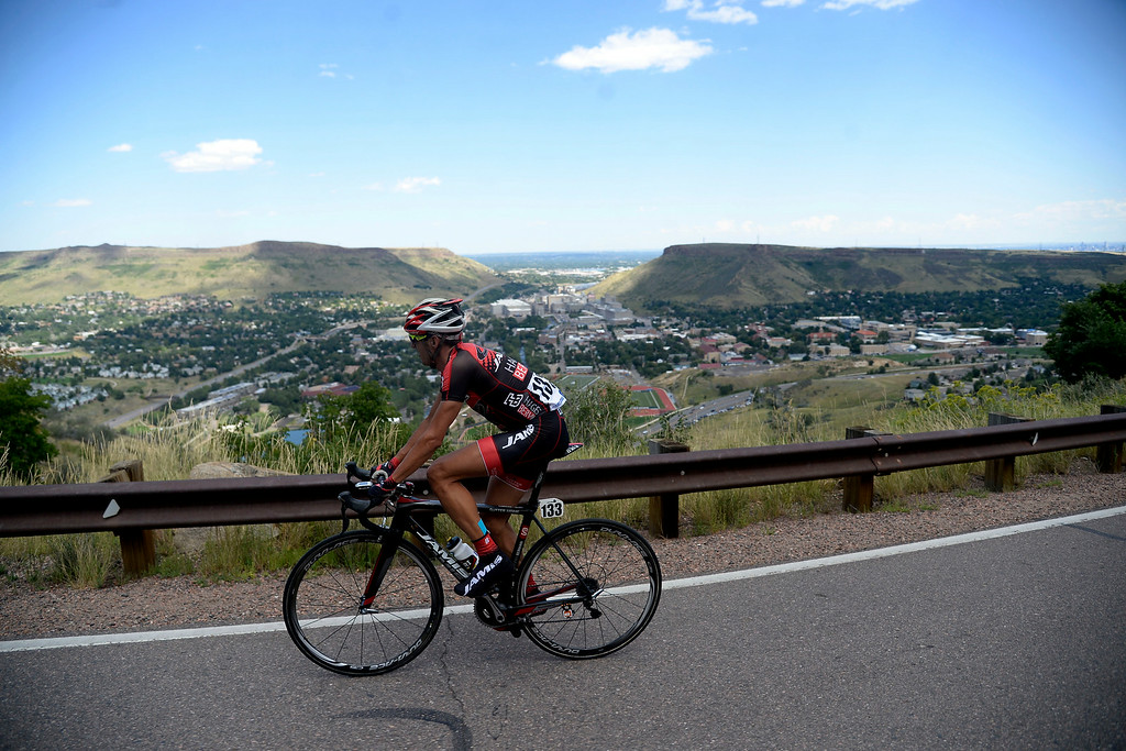 . Matt Cooke looks out over Golden from Lookout Mountain during stage 7. The USA Pro Challenge stage 7 on Sunday, August 24, 2014. (Photo by AAron Ontiveroz/The Denver Post)