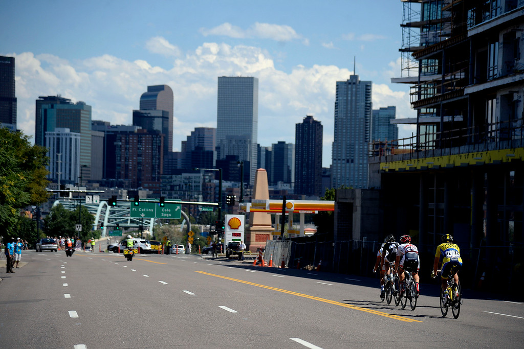. The lead pack makes their way towards downtown Denver during stage 7 The USA Pro Challenge stage 7 on Sunday, August 24, 2014. (Photo by AAron Ontiveroz/The Denver Post)