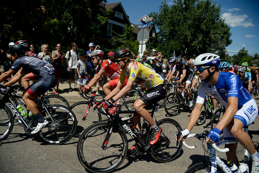 . Overall winner Tejay van Garderen (center) makes a pass down Walnut at the start of stage 7 in downtown Boulder. The USA Pro Challenge stage 7 on Sunday, August 24, 2014. (Photo by AAron Ontiveroz/The Denver Post)