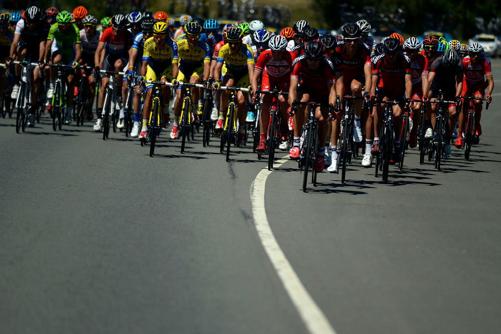 . Racers cruise in a large pack on CO-93 during stage 7. The USA Pro Challenge stage 7 on Sunday, August 24, 2014. (Photo by AAron Ontiveroz/The Denver Post)