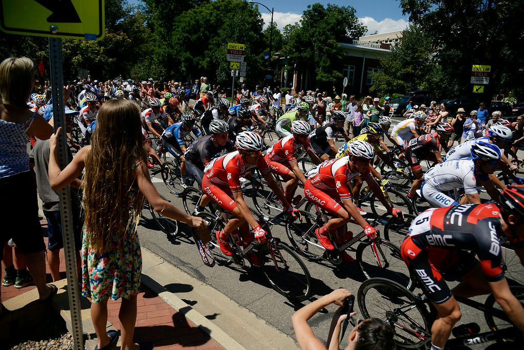 . Fans cheer on Riders at the start of stage 7 in downtown Boulder. The USA Pro Challenge stage 7 on Sunday, August 24, 2014. (Photo by AAron Ontiveroz/The Denver Post)