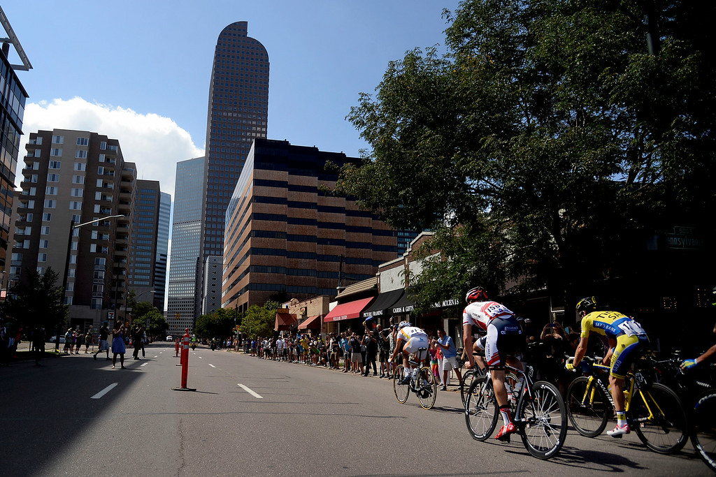 . Riders led by Javier Megias Leal make a loop through downtown Denver during stage 7. The USA Pro Challenge stage 7 on Sunday, August 24, 2014. (Photo by AAron Ontiveroz/The Denver Post)