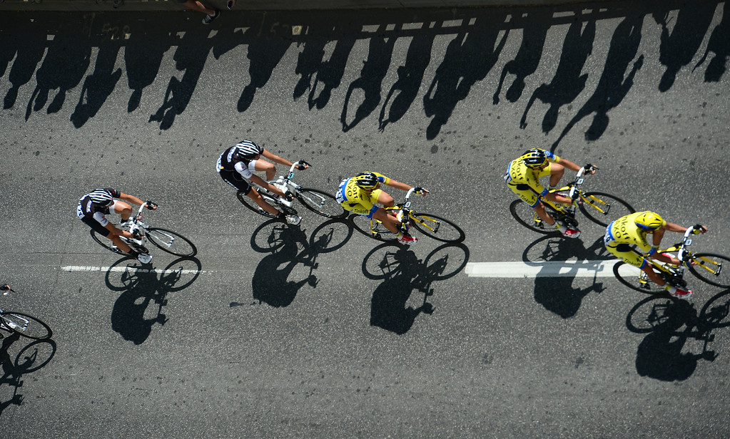 . USA Pro Challenge racers make their way along Colfax ave next to the Civic Center in Denver, CO on August 24, 2014.  The race finished in downtown after 7 stages racing throughout Colorado.   (Photo By Helen H. Richardson/The Denver Post)